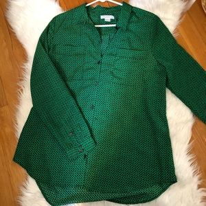 Kelly green blouse with black dots.